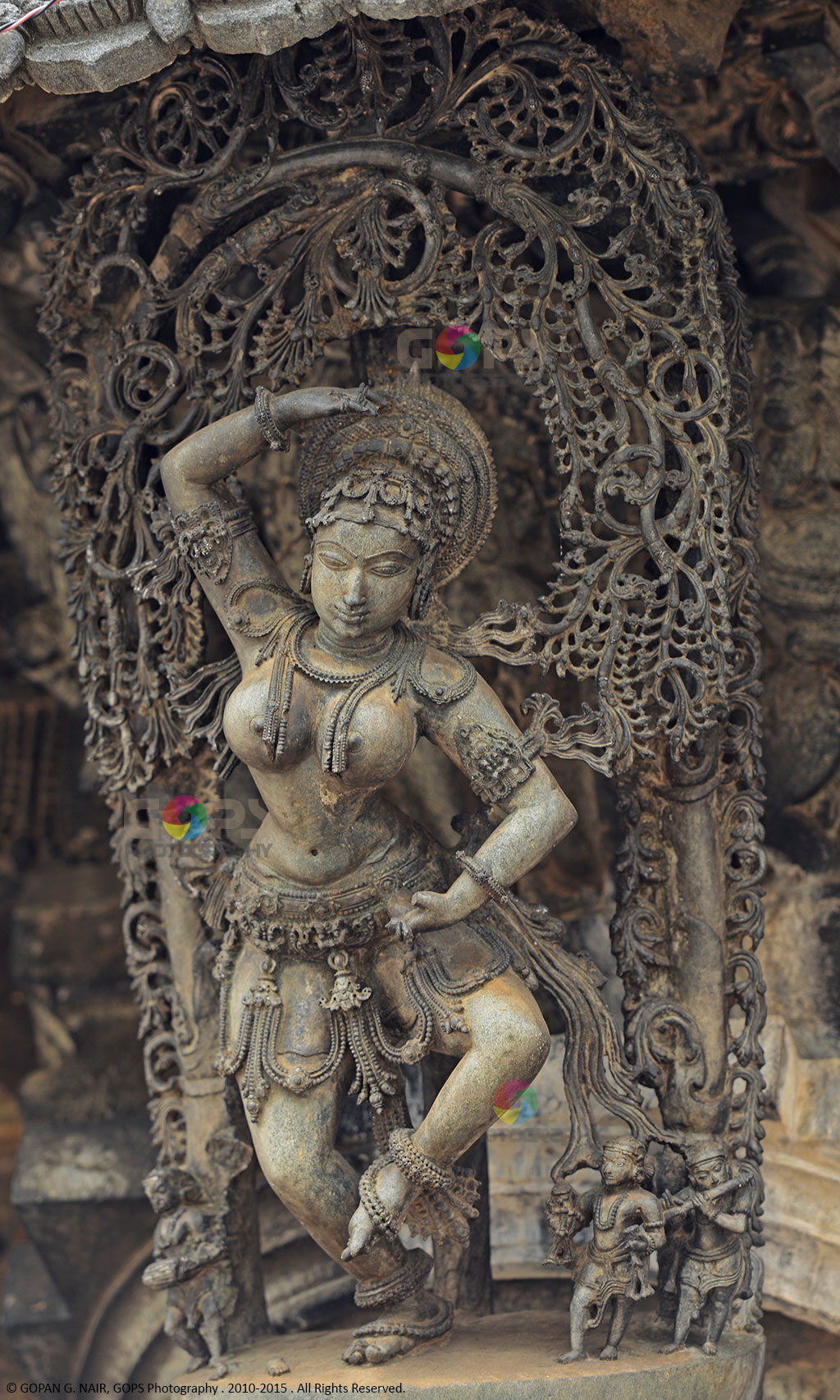 STATUE OF MOHINI, IN THE MOST PERFECT DANCE POSTURE. IT HAS BEEN CONSTRUCTED IN PERFECT SYMMETRY, SO THAT IF YOU LET A DROP OF WATER FALL FROM THE TIP OF HER RIGHT HAND RAISED ABOVE THE HEAD, IT WOULD TOUCH HER NOSE, THEN TOUCH THE LEFT BREAST, TIP OF THE LEFT HAND AND FINALLY LAND ON THE TOE OF HER LEFT FOOT