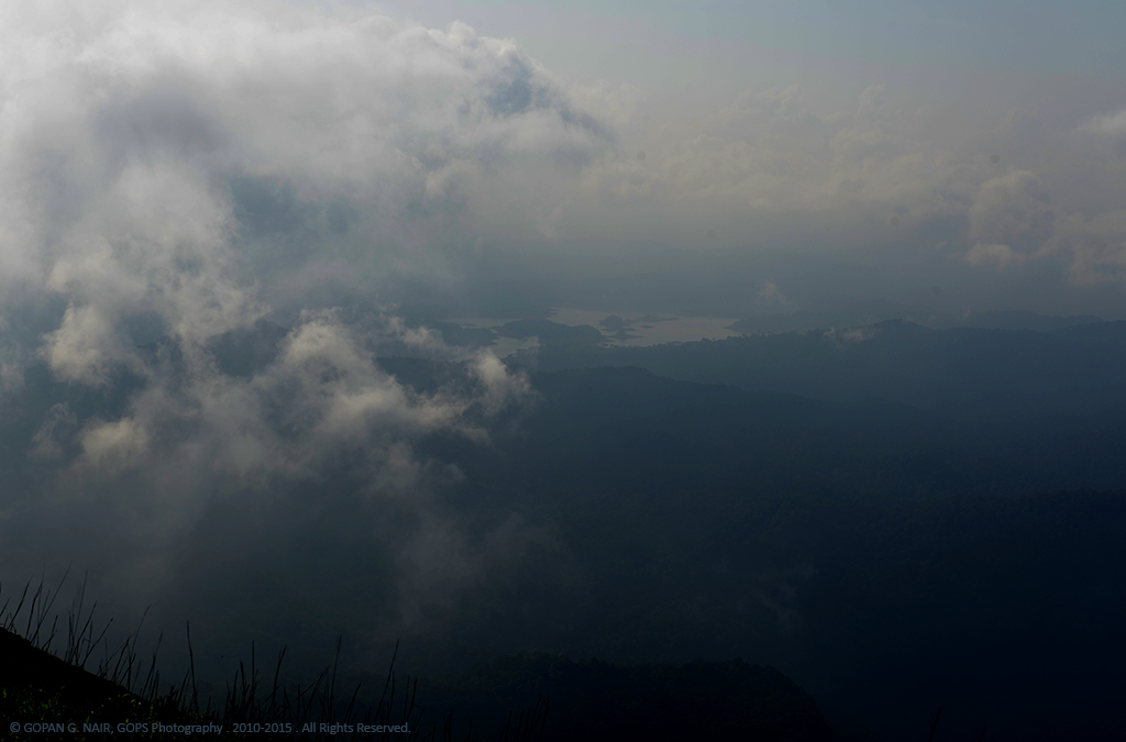DISTANT VIEW OF SHARAVATHI RIVER BACK-WATERS SEEN THROUGH THE CLOUDS