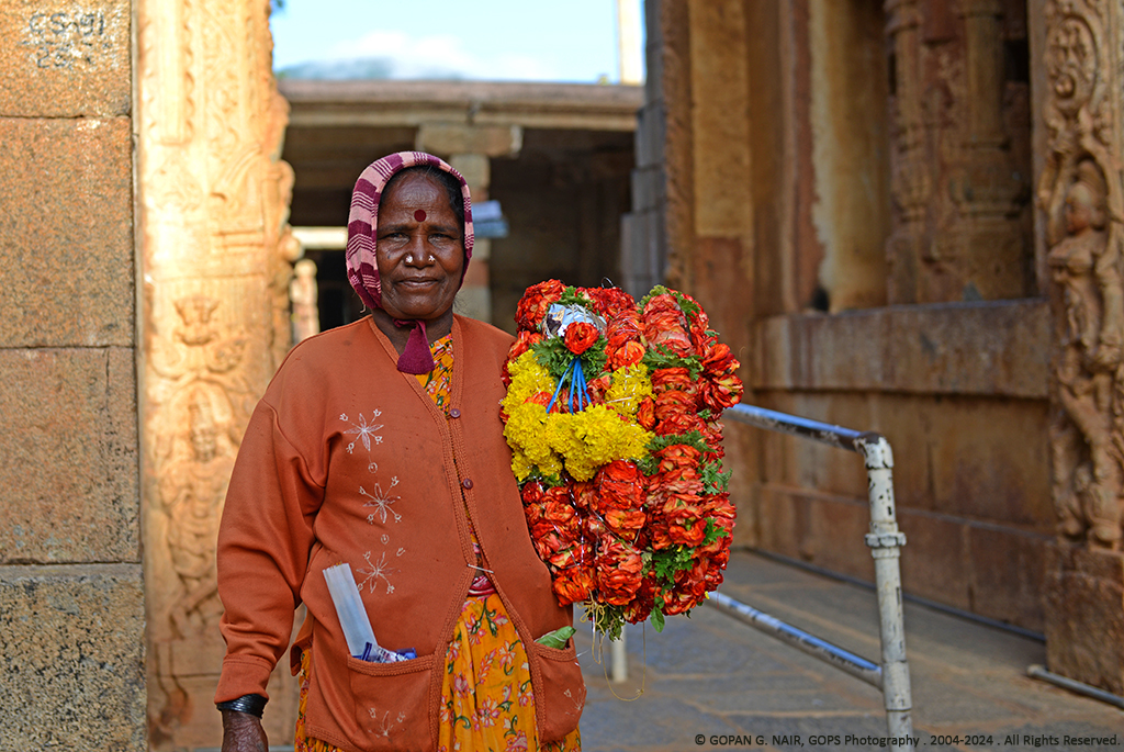 A LADY SELLING FLOWERS, IN FRONT OF THE TEMPLE