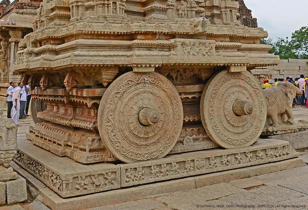 A CLOSE LOOK AT THE EXQUISITELY CARVED CHARIOT WHEELS