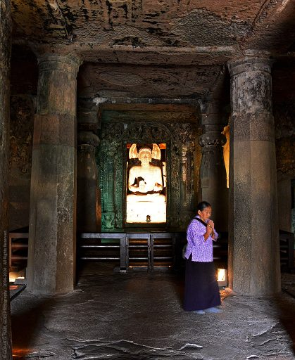 A BUDDHIST DEVOTEE INSIDE CAVE-6, AJANTA CAVES