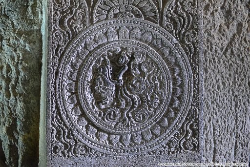 INTRICATE CARVING FOUND ON A PILLAR AT AJANTA CAVES