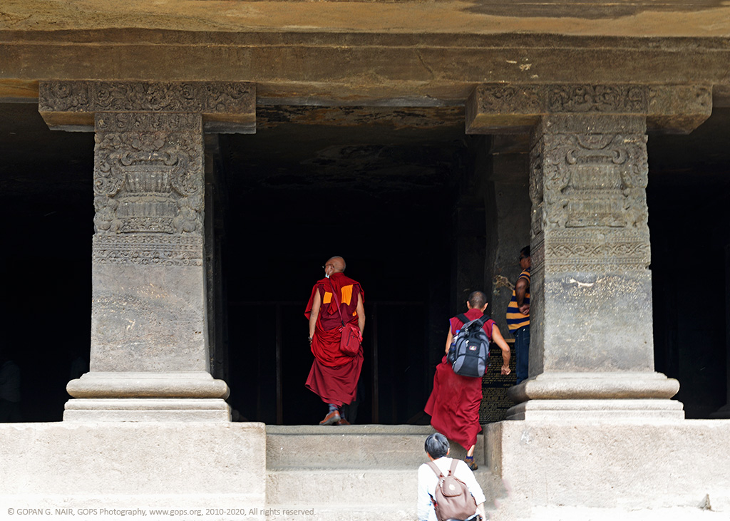 IN SEARCH OF THEIR ROOTS. IN A BUDDHIST CAVE AT ELLORA, INDIA